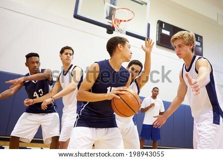 Male High School Basketball Team Playing Game