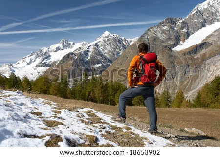 Male hiker enjoying the view over the beautiful landscape of Mont Blanc, Courmayeur, Italy