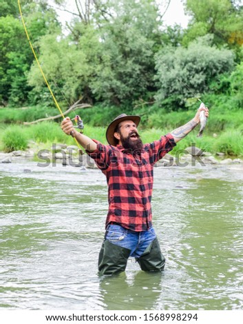 male hobby. hobby and sport activity. fisherman show fishing technique use rod. summer weekend. Happy fly fishing. bearded fisher in water. mature man fly fishing. man catching fish. #1568998294