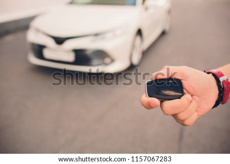 Free Photos Male Holding Car Keys With Car On Background Avopix Com