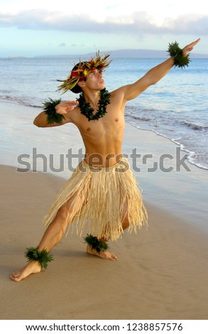 Male Hula Dancer performs traditional hula on the beach.