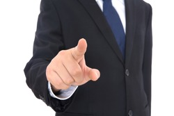Male in black suit in front of white background stretches out his right hand to make click gesture