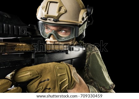 Male in uniform of Tactical Units of Police with rifle. Shot in studio. Isolated with clipping path on black background
