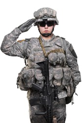 Male in US Army uniform soldier saluting (Flag of the USA on the shoulder). Shot in studio. Isolated with clipping path on white background