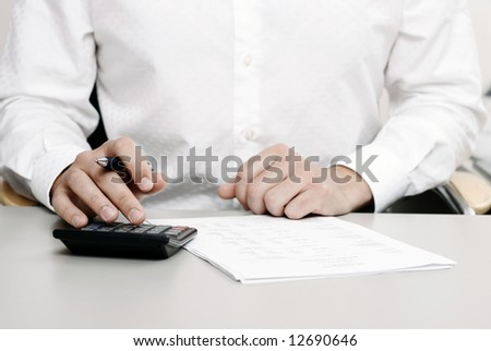 male in white shirt completing a blank form