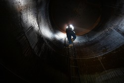 Male inside climb the stairway storage heavy fuel oil visual tank inspection into the confined space