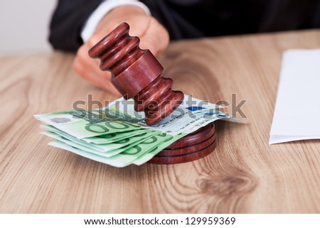 Male Judge Striking The Gavel Euro Note In A Courtroom