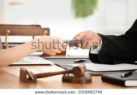 Male judge taking bribe from woman, closeup #1018482748
