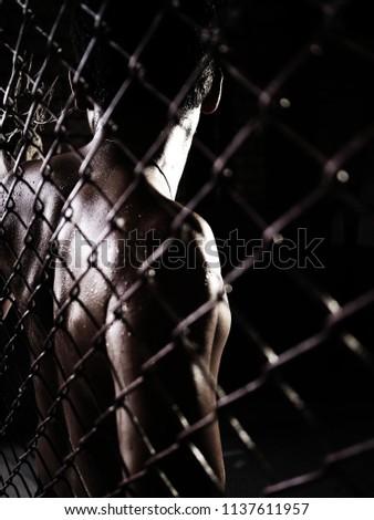 Male labor worker Imprisoned dark  (focu back ) Stock photo ©