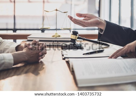 Male lawyer or judge consult having team meeting with Businesswoman client, Law and Legal services concept. #1403735732