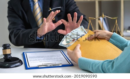 Male lawyer rejects bribes offered by businesswoman To allow lawyers to help form illegal cases in court, bribes corruption illegal fraud bribery concept. ストックフォト ©