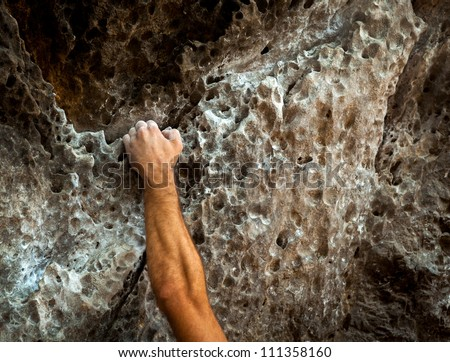 male left hand with chalk powder in cliff climbing sport, Ao Nang, Krabi, Thailand.