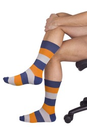Male legs in colorful socks. Isolated on white background