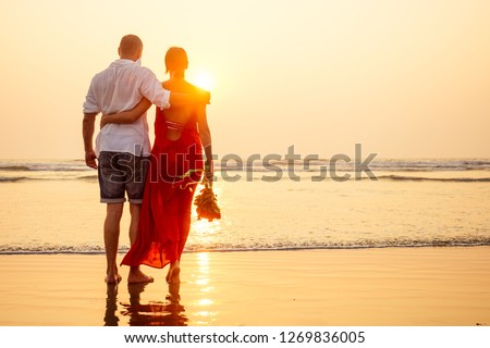 male making proposal with engagement ring to his girlfriend at sea beach.Valentine's Day February 14 wedding concept.man on his knee making a marriage proposal to his woman sunset romantic I said yes