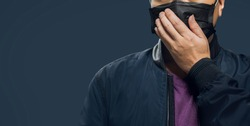 Male male model wearing dark blue long-sleeved shirt side angle wearing glasses wearing a black mask Prevent COVID-19 work billboard dark blue background illustration