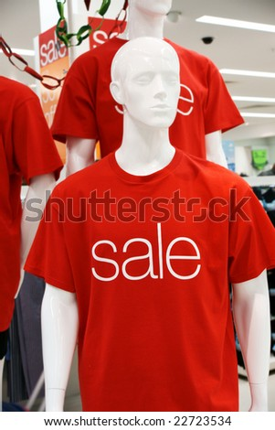 "male mannequins in ""sale"" t-shorts"