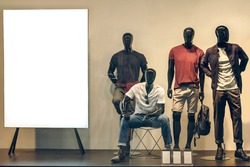 Male mannequins near a stand in a shop window. Spring summer collection men's fashion. Shopping