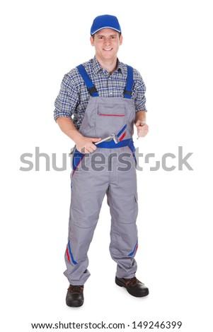 Male mechanic holding ratchet isolated on white background