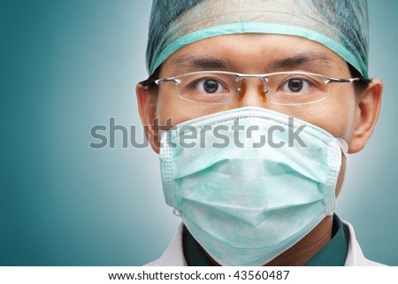 Male medical worker looking seriously to camera