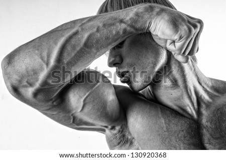 Male model kissing his biceps