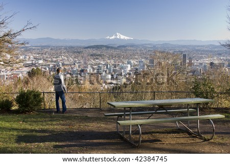 Male model overlooking city of Portland, Oregon.