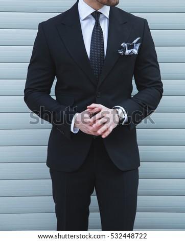Male model posing in a black suit
