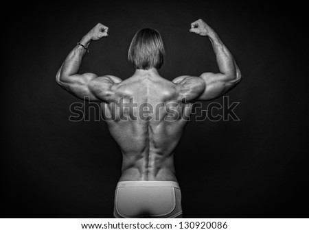 Male model showing his strong back