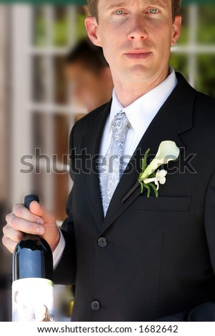 Male model wedding groom with wine.