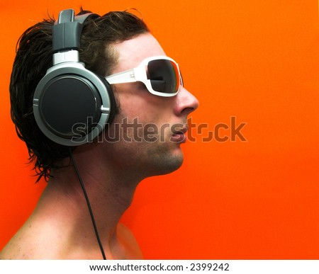 Male Model With Headphones, (Side View) Stock Photo ...