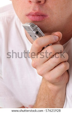 Male mouth and dictaphone. Close-up