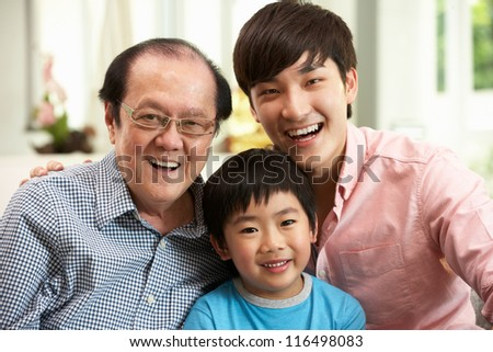 Male Multi Genenration Chinese Family Group Relaxing At HomeTogether