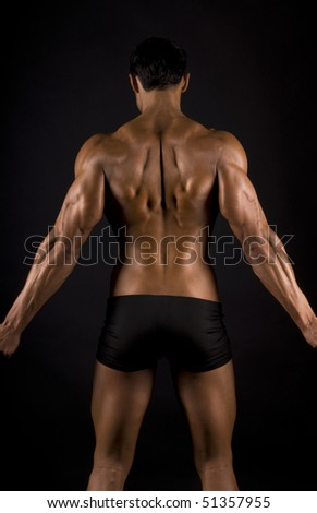 male muscular back on black background. #51357955