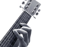 male musician hands playing guitar. black and white, isolated on white