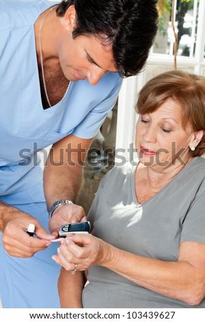 Free Blood Glucose Meter >> Male Nurse Measuring Glucose Level Blood Test Using Glucometer And Sample Strip Stock Photo ...