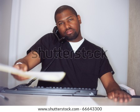 Male nurse working on computer