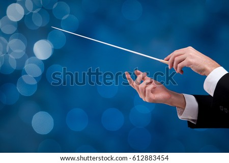 Male orchestra conductor hands with gesture, one with baton. Leadership and manager concepts. #612883454