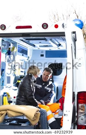 Male Paramedic Assisting Injured Woman