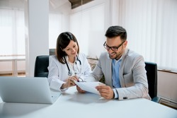 Male patient consulting doctor in clinic
