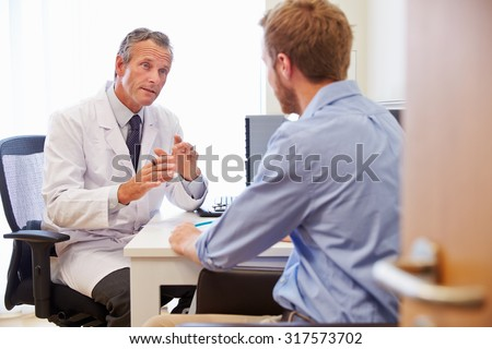 Male Patient Having Consultation With Doctor In Office #317573702