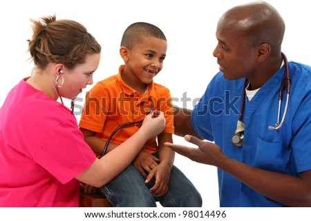 Male Pediatrician and Nurse Performing An Exam On Young Black Child