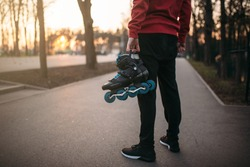 Male person hands with roller skates
