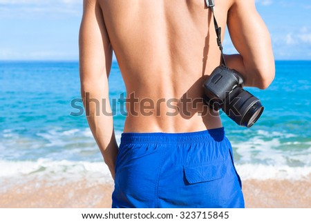 Male photographer on the beach.