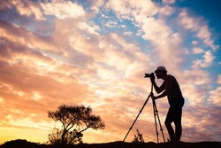 Male photographer taking photos in a beautiful nature setting.