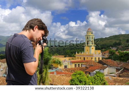 Male photographer taking pictures in Trinidad town, cuba