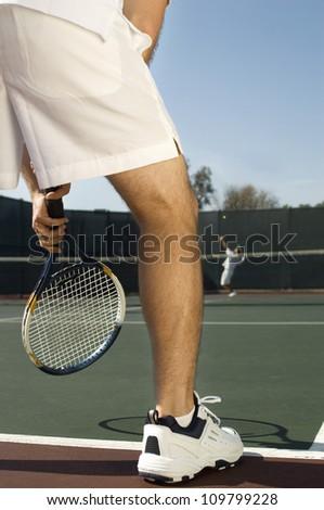 Male players playing tennis match