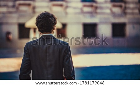 male portrait standing alone in the city. back view. Selective focus ストックフォト ©