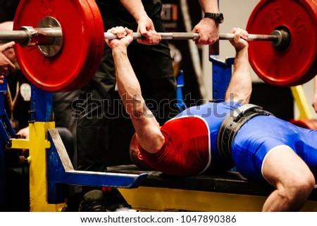 male powerlifter bench press in powerlifting competition