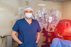 Male professional surgeon standing in mask in new modern clinic. Surgery healthcare treatment.