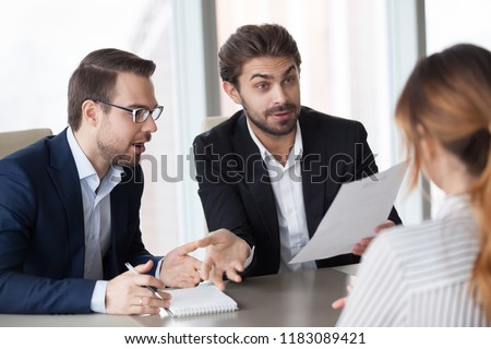 Male recruiters surprised by work achievements or experience in resume of female job applicant during interview, amazed HR managers shocked with woman candidate career. Good first impression concept #1183089421
