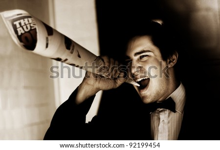Male Reporter Or Journalist Shouting Yelling And Screaming Out The End Of A Newspaper While Making A Press Release Announcement On An Informative News Update